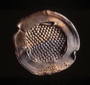 Plate, 1989. Stoneware, wheel-thrown, ornament made by pushing the wet clay with fingertip against rubber foam, manganese-copper glaze, crushed seashells, anagram-fired. Dia. 55 cm. Private collection.